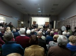 Standing room only in the packed village hall.