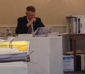 Planning Inspector Gareth Jones surrounded by files